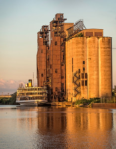 """Marine A Silo's with the 'Columbia"""" parked next to it."""