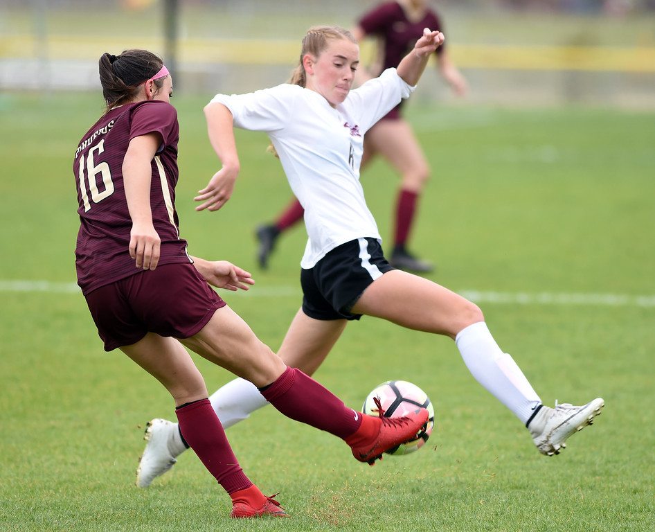 . Kyla Thornhill, of Ponderosa, kicks past Kate Eggen, of Silver Creek. Silver Creek beats Ponderosa 2-1 in overtime in Longmont on Saturday. For more photos, go to dailycamera.com.  Cliff Grassmick / Staff Photographer/ May 12, 2018