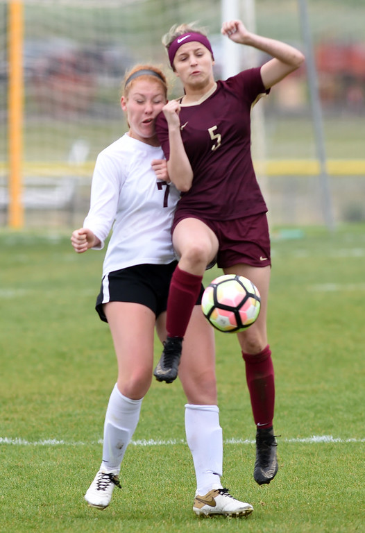 . Colleen Tyrrell, left, of Silver Creek, and Allie Conard, of Ponderosa, collide going for the ball. Silver Creek beats Ponderosa 2-1 in overtime in Longmont on Saturday. For more photos, go to dailycamera.com.  Cliff Grassmick / Staff Photographer/ May 12, 2018