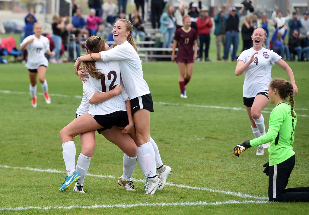 . Alexa Karsel (12) of Silver Creek, scores the winning goal past Morgan Palermo, right, of Ponderosa. Colleen Tyrrell comes from the left for a hug, while Kate Eggen, comes from the right. Alexa Karsel (12) of Silver Creek, scores the winning goal past Morgan Palermo, right, of Ponderosa. Colleen Tyrrell comes from the left for a hug, while Kate Eggen, comes from the right. Silver Creek beats Ponderosa 2-1 in overtime in Longmont on Saturday. For more photos, go to dailycamera.com.  Cliff Grassmick / Staff Photographer/ May 12, 2018