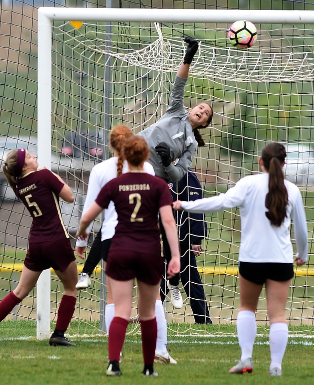 . Keeper, Kaeyla Noble, protects the goal for Silver Creek. Silver Creek beats Ponderosa 2-1 in overtime in Longmont on Saturday. For more photos, go to dailycamera.com.  Cliff Grassmick / Staff Photographer/ May 12, 2018