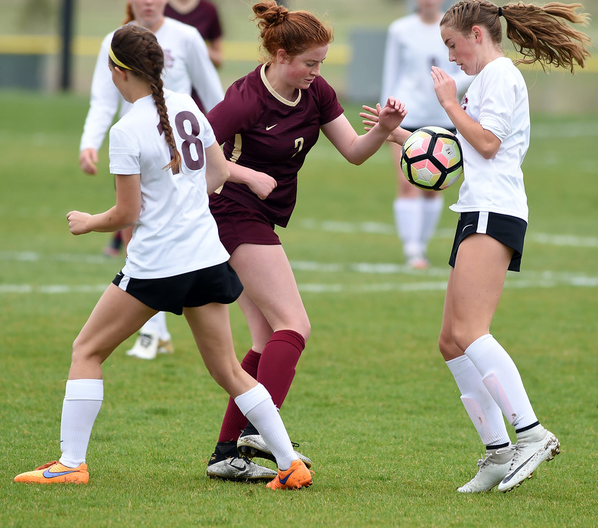 . Kayla Gunnsauls, left, of Ponderosa, kicks the ball into the chest of Kate Eggen, of Silver Creek. Silver Creek beats Ponderosa 2-1 in overtime in Longmont on Saturday. For more photos, go to dailycamera.com.  Cliff Grassmick / Staff Photographer/ May 12, 2018
