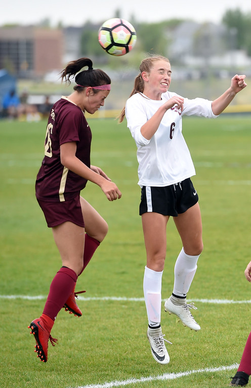 . Kyla Thornhill, left, of Ponderosa, and Kate Eggen, of Silver Creek, connect with their heads. Silver Creek beats Ponderosa 2-1 in overtime in Longmont on Saturday. For more photos, go to dailycamera.com.  Cliff Grassmick / Staff Photographer/ May 12, 2018