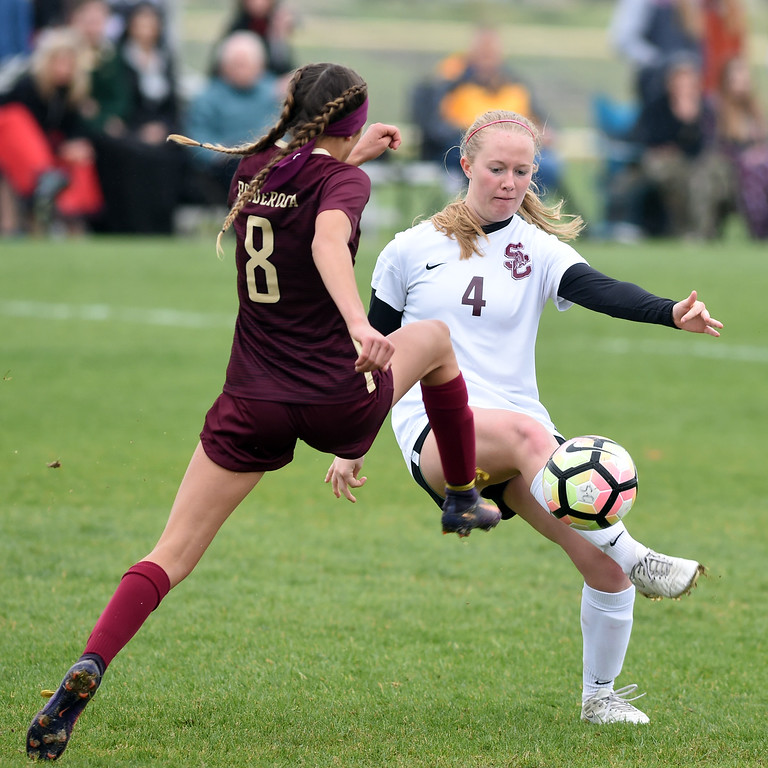 . Emma Seufer, left, of Ponderosa, kicks into Annalise Teasdale, of Silver Creek. Silver Creek beats Ponderosa 2-1 in overtime in Longmont on Saturday. For more photos, go to dailycamera.com.  Cliff Grassmick / Staff Photographer/ May 12, 2018