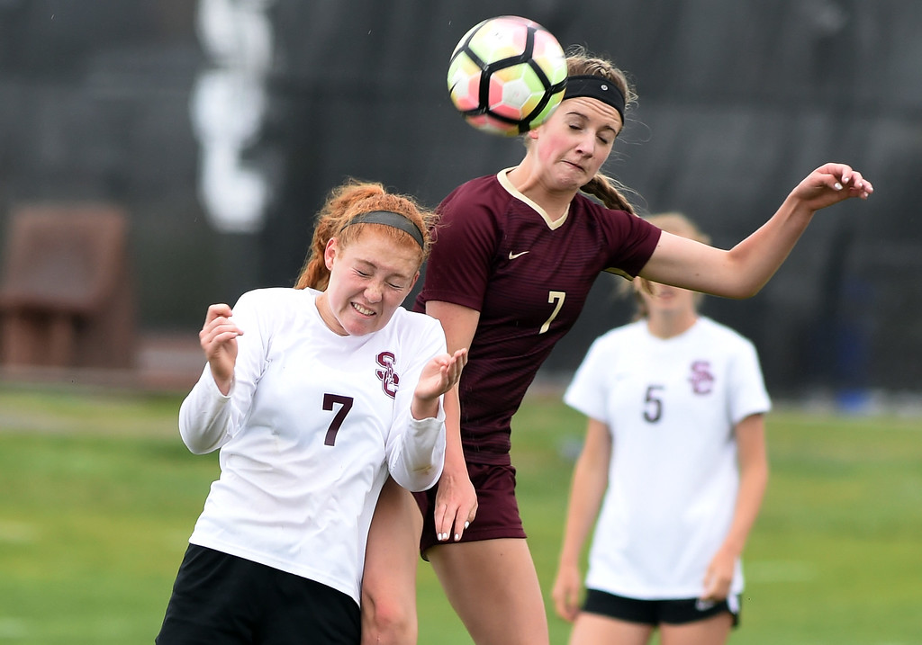 . Colleen Tyrrell, of Silver Creek, and Kayla Gunsauls, of Ponderosa, on the header. Silver Creek beats Ponderosa 2-1 in overtime in Longmont on Saturday. For more photos, go to dailycamera.com.  Cliff Grassmick / Staff Photographer/ May 12, 2018