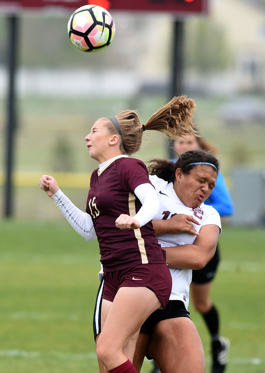 . Emma Everts, of Ponderosa, and Margaret Goldsberry, of Silver Creek make contact on a header. Silver Creek beats Ponderosa 2-1 in overtime in Longmont on Saturday. For more photos, go to dailycamera.com.  Cliff Grassmick / Staff Photographer/ May 12, 2018