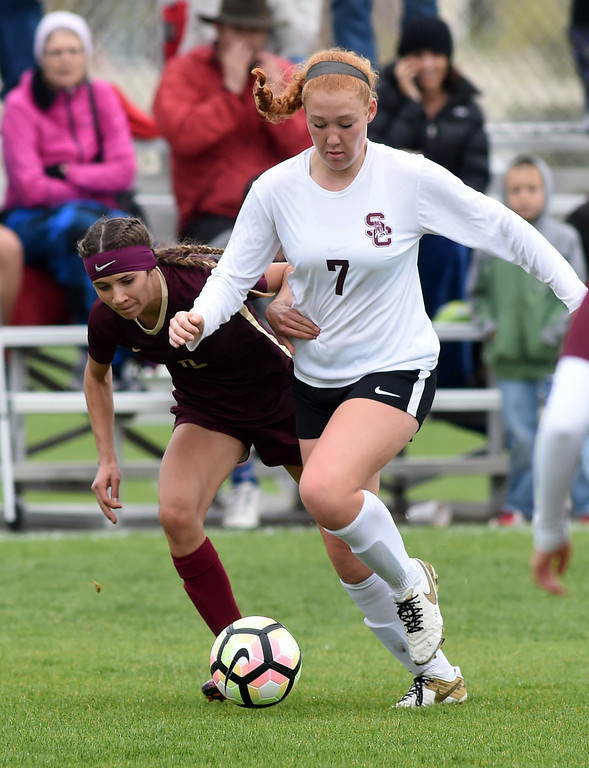 . Colleen Tyrrell, of Silver Creek battles with the Ponderosa defender. Silver Creek beats Ponderosa 2-1 in overtime in Longmont on Saturday. For more photos, go to dailycamera.com.  Cliff Grassmick / Staff Photographer/ May 12, 2018