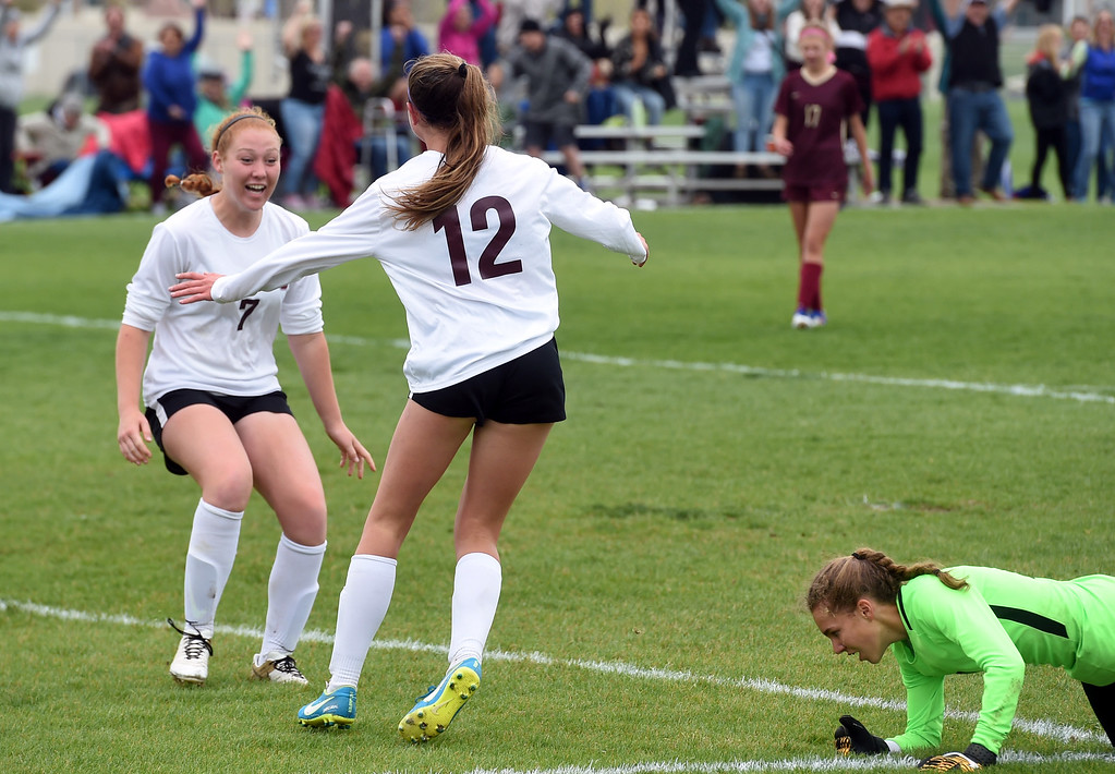 . Alexa Karsel (12) of Silver Creek, scores the winning goal past Morgan Palermo, right, of Ponderosa. Colleen Tyrrell comes from the left for a hug. Silver Creek beats Ponderosa 2-1 in overtime in Longmont on Saturday. For more photos, go to dailycamera.com.  Cliff Grassmick / Staff Photographer/ May 12, 2018