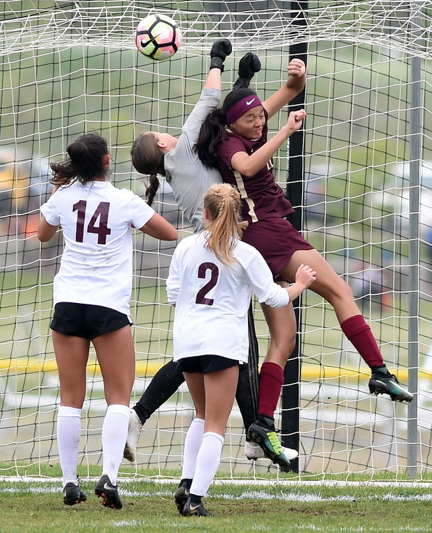 . Keeper, Kaeyla Noble, protects the goal for Silver Creek against the push by Carolyn Ho, of Ponderosa. Silver Creek beats Ponderosa 2-1 in overtime in Longmont on Saturday. For more photos, go to dailycamera.com.  Cliff Grassmick / Staff Photographer/ May 12, 2018