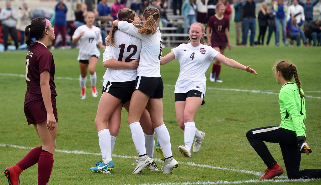 . Alexa Karsel (12) of Silver Creek, scores the winning goal past Morgan Palermo, right, of Ponderosa. Colleen Tyrrell comes from the left for a hug, while Kate Eggen and Annalise Teasdale,  comes from the right. Silver Creek beats Ponderosa 2-1 in overtime in Longmont on Saturday. For more photos, go to dailycamera.com.  Cliff Grassmick / Staff Photographer/ May 12, 2018