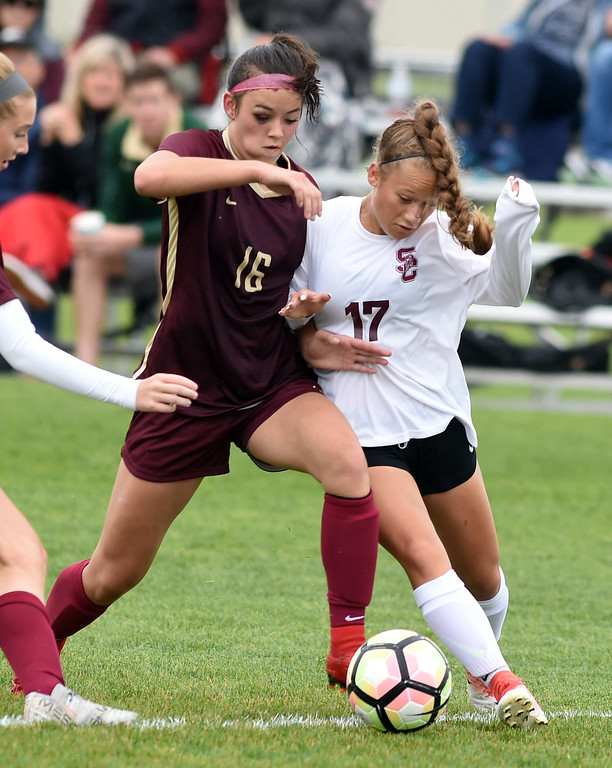 . Kyla Thornhill, of Ponderosa, and Jordy Victor, of Silver Creek get physical.Silver Creek beats Ponderosa 2-1 in overtime in Longmont on Saturday. For more photos, go to dailycamera.com.  Cliff Grassmick / Staff Photographer/ May 12, 2018