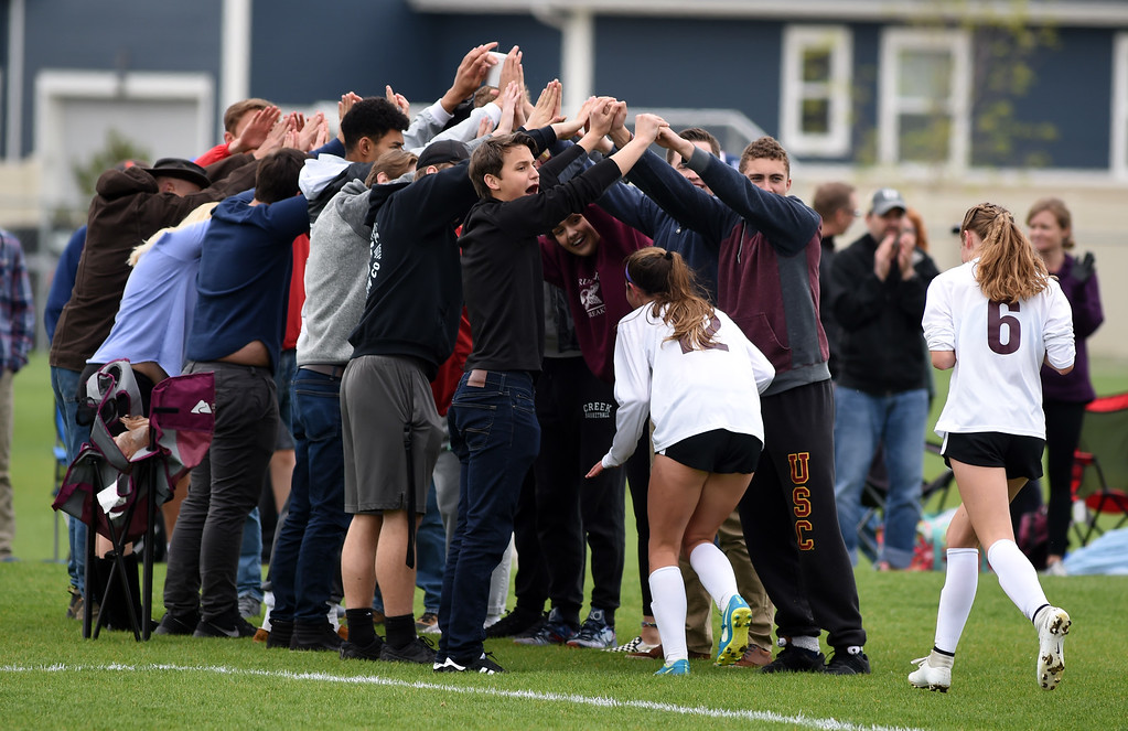 . The Silver Creek fans form a tunnel for the winning Raptors. Silver Creek beats Ponderosa 2-1 in overtime in Longmont on Saturday. For more photos, go to dailycamera.com.  Cliff Grassmick / Staff Photographer/ May 12, 2018
