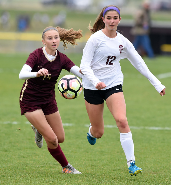. Emma Everts, left, of Ponderosa, and Alexa Karsel, of Silver Creek, chase down a ball. Silver Creek beats Ponderosa 2-1 in overtime in Longmont on Saturday. For more photos, go to dailycamera.com.  Cliff Grassmick / Staff Photographer/ May 12, 2018
