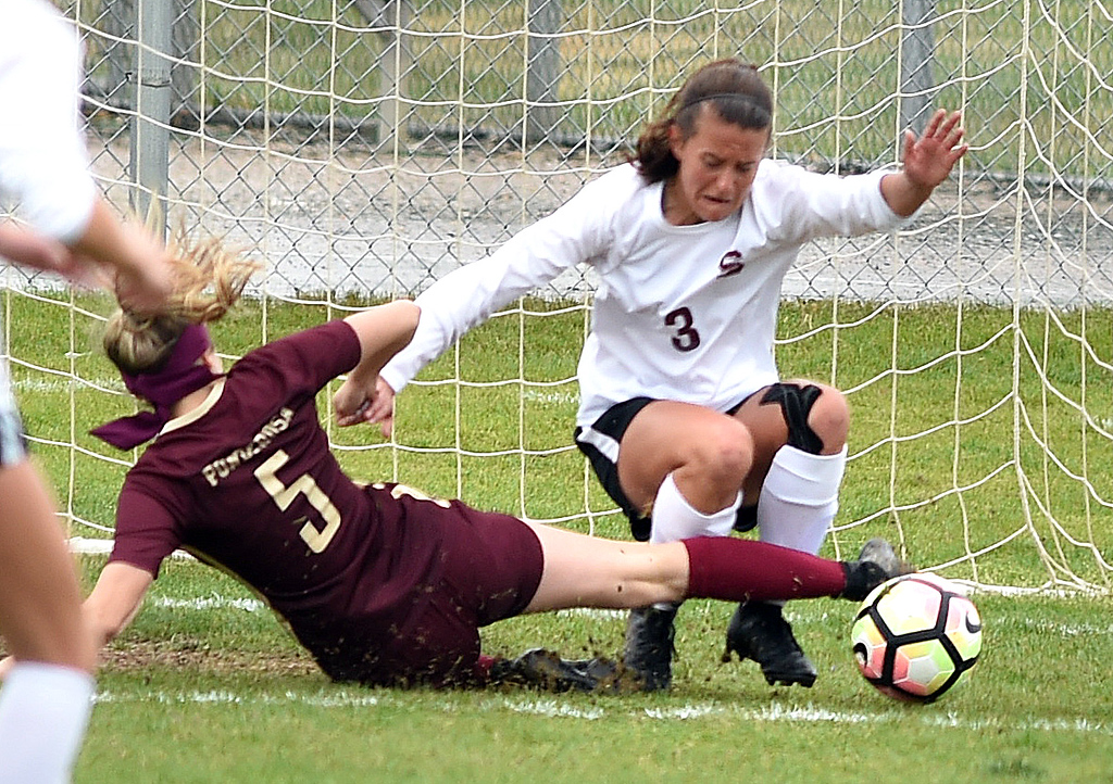 . Holly Bosley, of Silver Creek, protects the goal from Allie Conard, of Ponderosa. Silver Creek beats Ponderosa 2-1 in overtime in Longmont on Saturday. For more photos, go to dailycamera.com.  Cliff Grassmick / Staff Photographer/ May 12, 2018