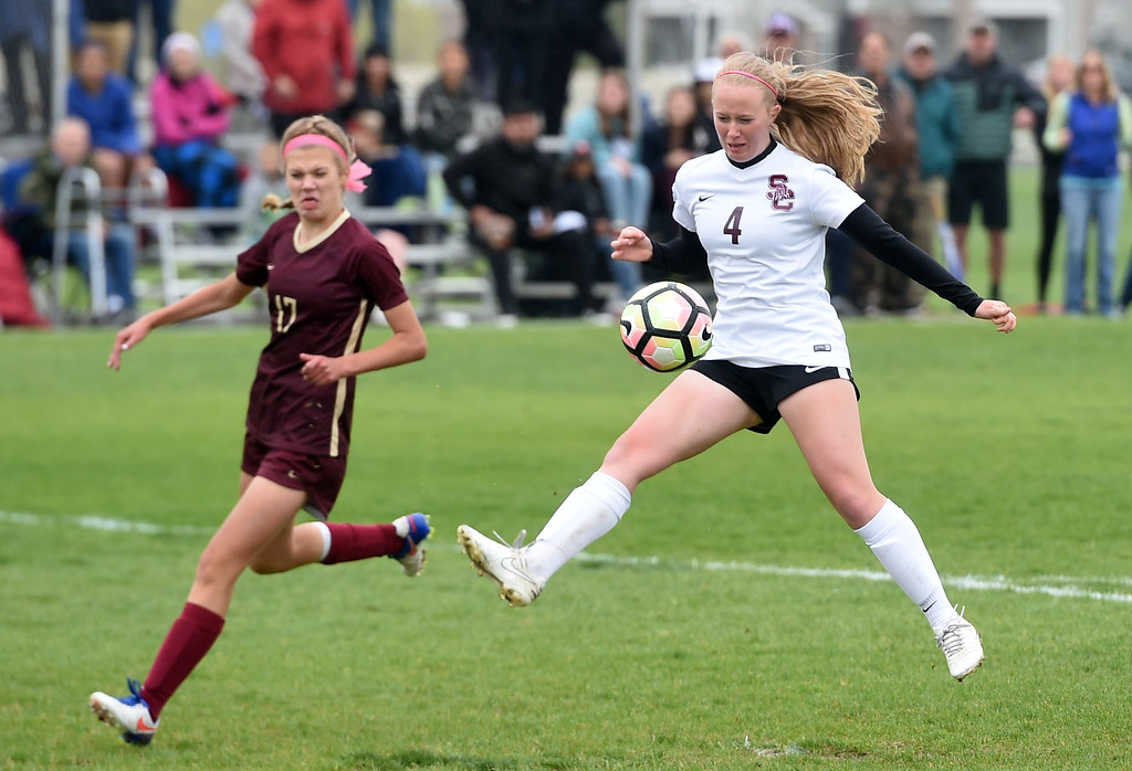 . Annalise Teasdale, of Silver Creek, tries to score on Jayda Goldschmidt, of Ponderosa. Silver Creek beats Ponderosa 2-1 in overtime in Longmont on Saturday. For more photos, go to dailycamera.com.  Cliff Grassmick / Staff Photographer/ May 12, 2018