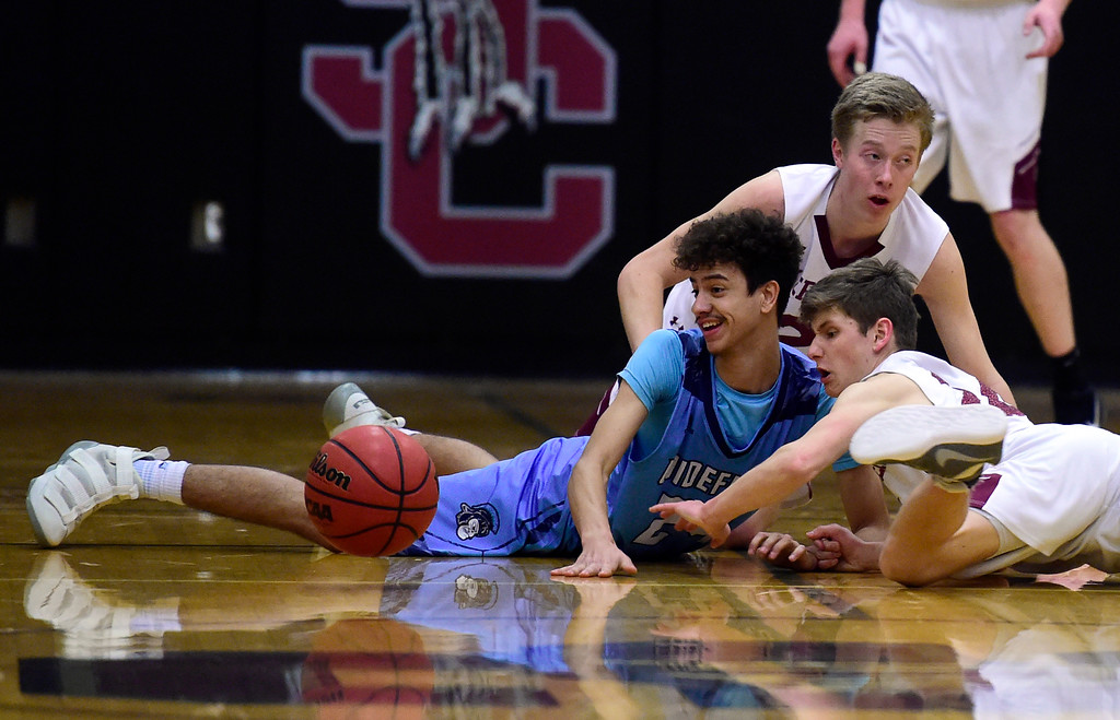 . Silver Creek High School\'s Ashton Hubert fights for a loose ball with Lucas Lacy during a Sweet 16 playoff game against Widefield on Wednesday in Longmont. Widefield won the game 54-51. More photos: BoCoPreps.com Jeremy Papasso/ Staff Photographer 02/28/2018