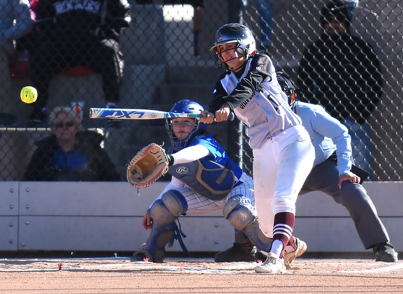 Silver Creek's Jetta Nannen hits an RBI doubles to right-center field during the Raptors' semifinal game against Pueblo Central at the Class 4A softball state championships on Saturday.<br /> Brad Cochi photo