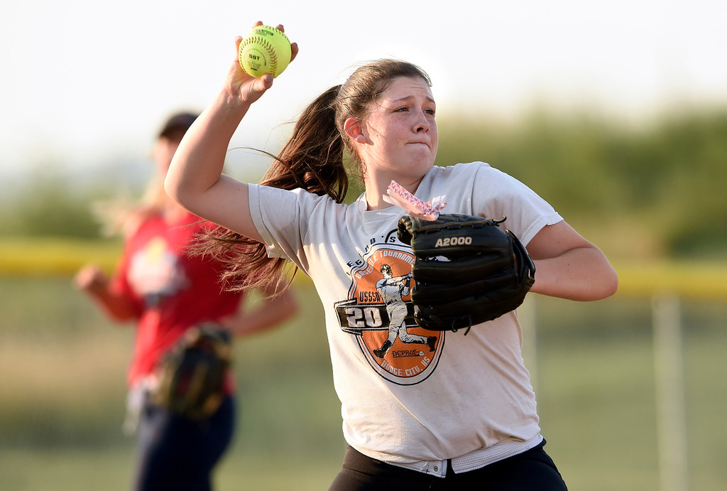 . Silver Creek High School\'s Bailey Beavers makes a throw to first base during softball practice on Tuesday in Longmont. More photos: BoCoPreps.com Jeremy Papasso/ Staff Photographer 08/07/2018