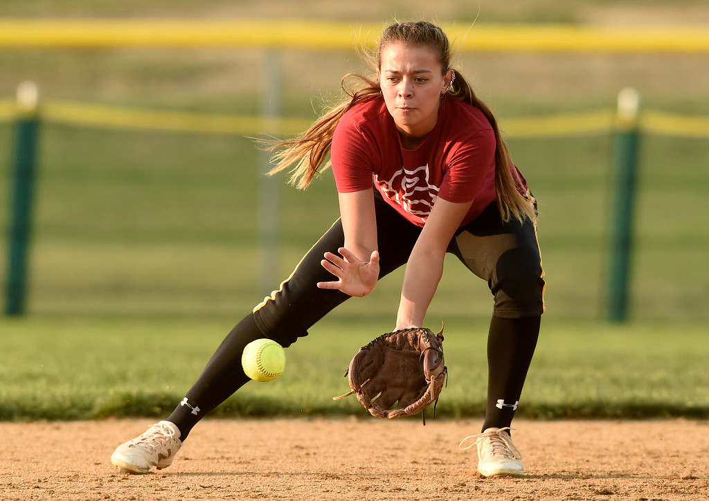 . Silver Creek High School\'s Kyla Harper stops a ground ball during softball practice on Tuesday in Longmont. More photos: BoCoPreps.com Jeremy Papasso/ Staff Photographer 08/07/2018