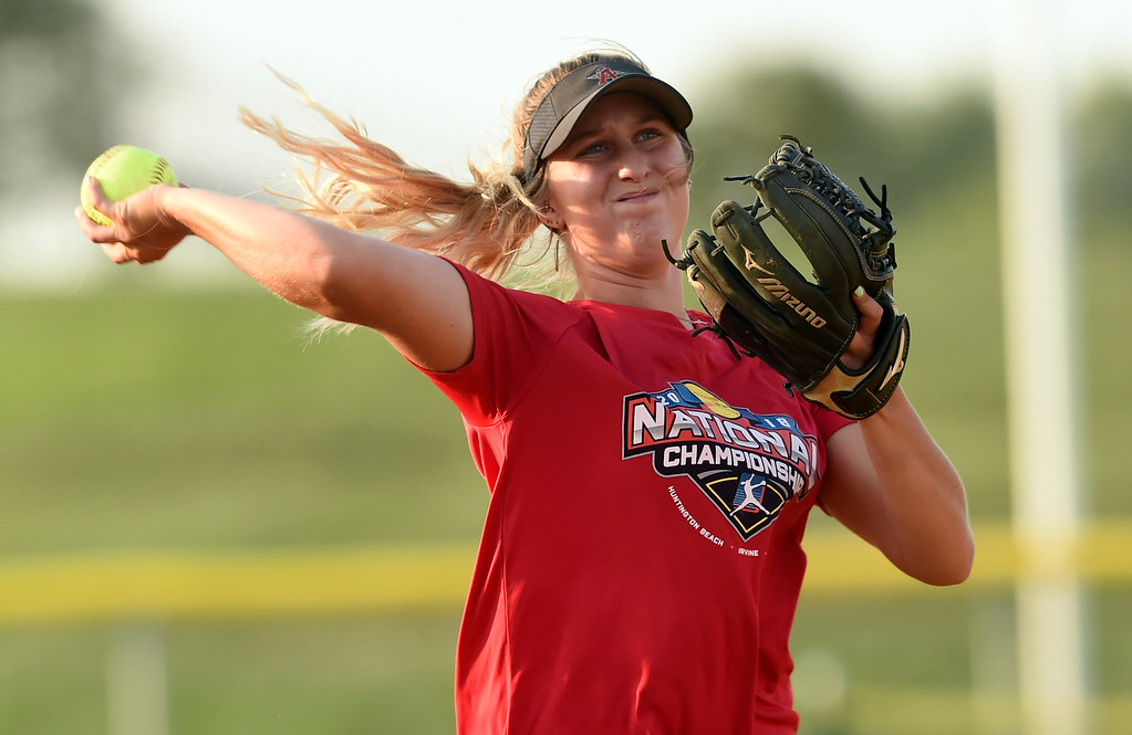 . Silver Creek High School\'s Jetta Nannen makes a throw to first base during softball practice on Tuesday in Longmont. More photos: BoCoPreps.com Jeremy Papasso/ Staff Photographer 08/07/2018