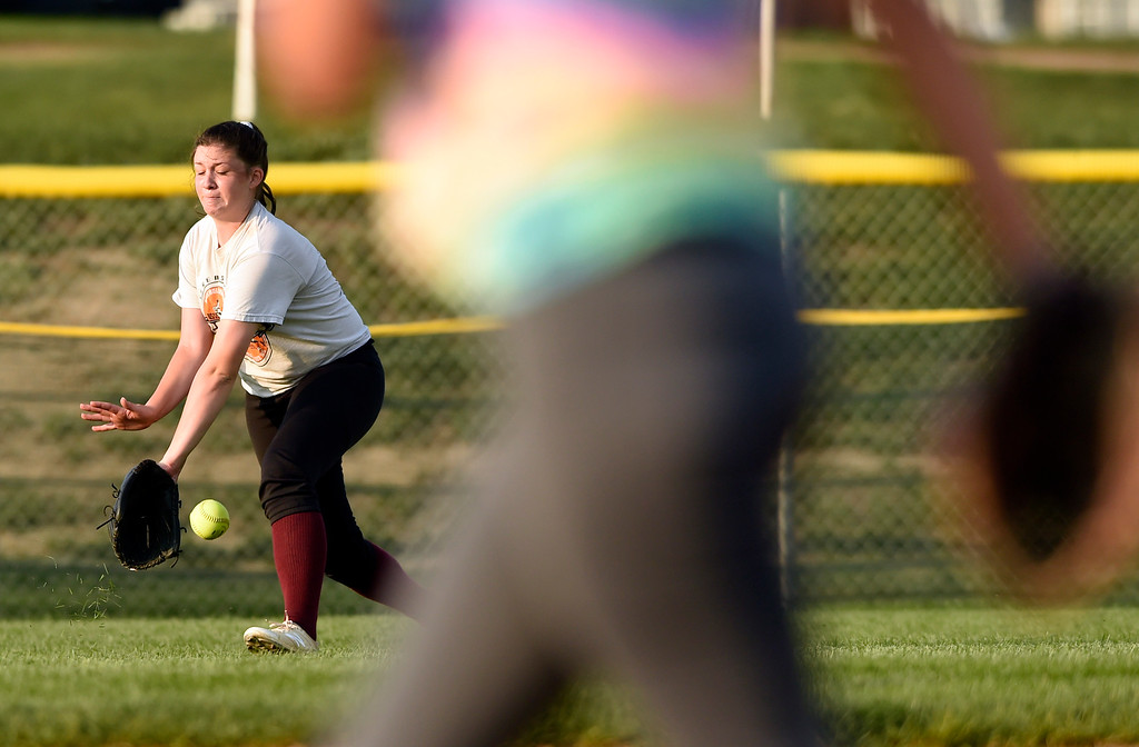 . Silver Creek High School\'s Bailey Beavers makes a stop in the outfield during softball practice on Tuesday in Longmont. More photos: BoCoPreps.com Jeremy Papasso/ Staff Photographer 08/07/2018
