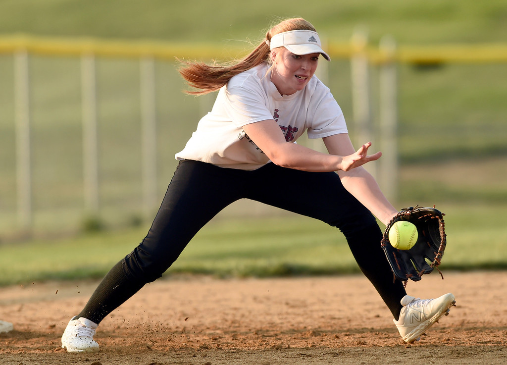 . Silver Creek High School\'s Lucy Scott makes a stop at third base during softball practice on Tuesday in Longmont. More photos: BoCoPreps.com Jeremy Papasso/ Staff Photographer 08/07/2018