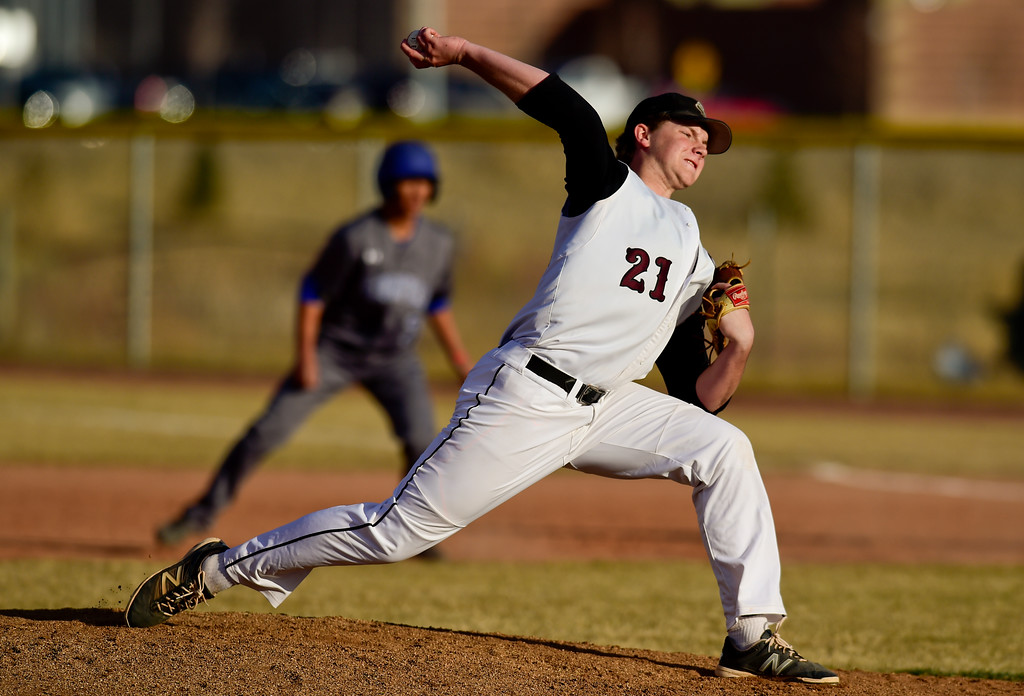 . Silver Creek High School\'s Trevor Ordway (No. 21) pitches against Broomfield High School in Longmont, Colorado on March 12, 2018. (Photo by Matthew Jonas/Staff Photographer)