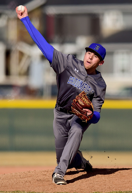 . Broomfield High School\'s Zach Macosko (No. 15) pitches against Silver Creek High School in Longmont, Colorado on March 12, 2018. (Photo by Matthew Jonas/Staff Photographer)