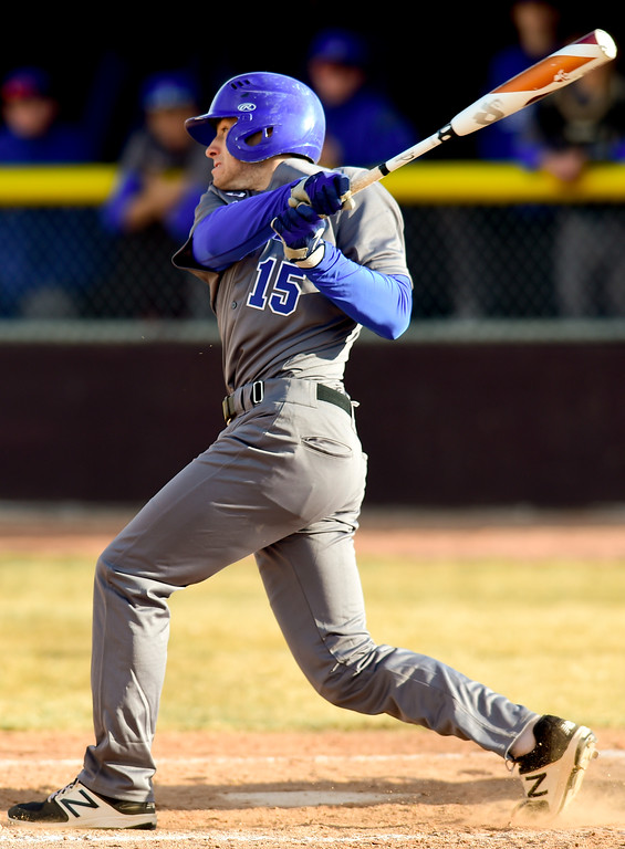 . Broomfield High School\'s Zach Macosko (No. 15) gets a hit but is thrown out at first in the game against Silver Creek High School in Longmont, Colorado on March 12, 2018. (Photo by Matthew Jonas/Staff Photographer)