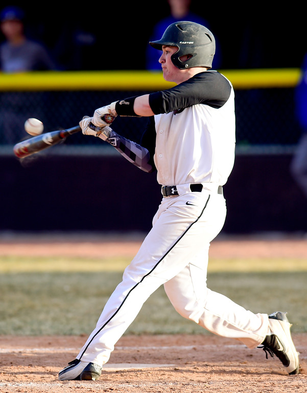 . Silver Creek High School\'s Justin Swenson (No. 14) gets a base hit single against Broomfield High School in Longmont, Colorado on March 12, 2018. (Photo by Matthew Jonas/Staff Photographer)