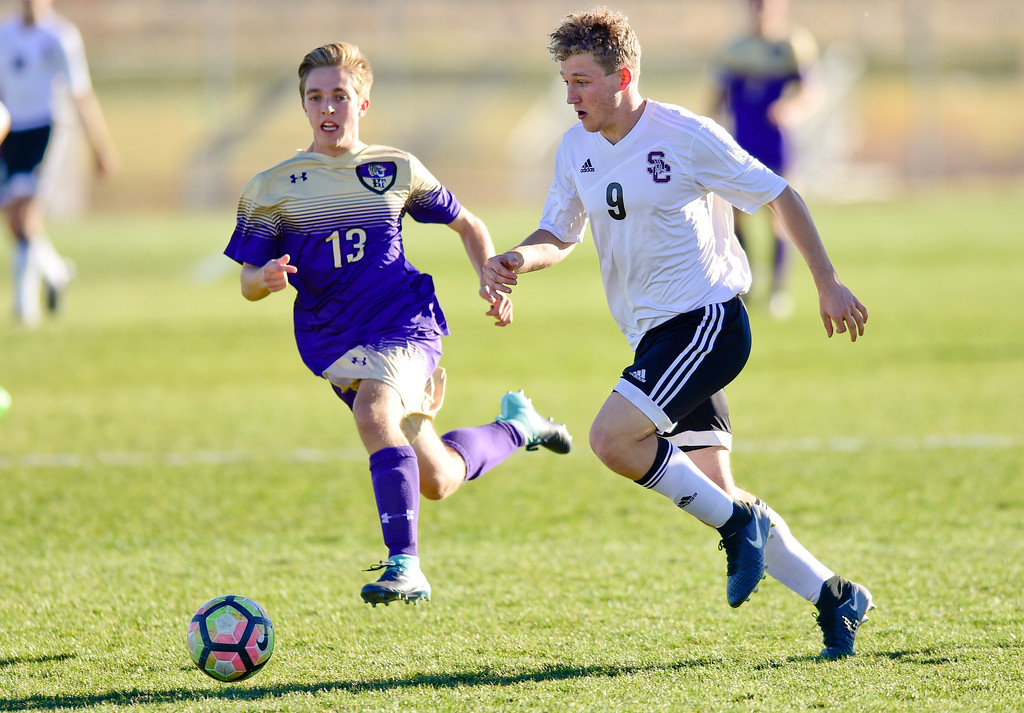 . Silver Creek Jake Levin (No. 9) drives toward the goal while followed by Holy Family Ryan Carter (No. 13) during the first round of class 4A soccer playoffs in Longmont, Colorado on Oct. 25, 2017.  (Photo by Matthew Jonas/Times-Call)
