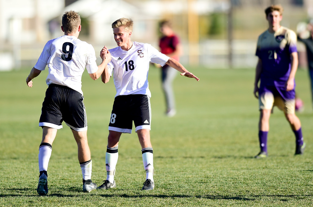 . Silver Creek Jake Levin (No. 9) celebrates his goal with Trey Gerlach (No. 18) against Holy Family during the first round of class 4A soccer playoffs in Longmont, Colorado on Oct. 25, 2017.  (Photo by Matthew Jonas/Times-Call)