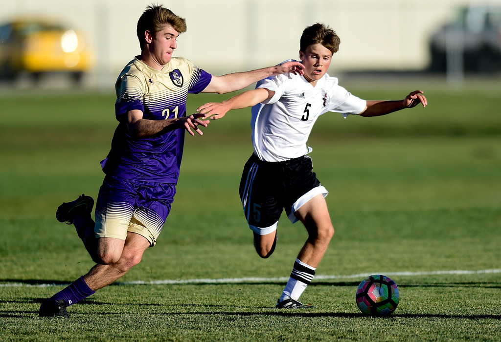 . Holy Family Tanner Baird (No. 21) battles with Silver Creek Simon Gerlach (No. 5) during the first round of class 4A soccer playoffs in Longmont, Colorado on Oct. 25, 2017.  (Photo by Matthew Jonas/Times-Call)