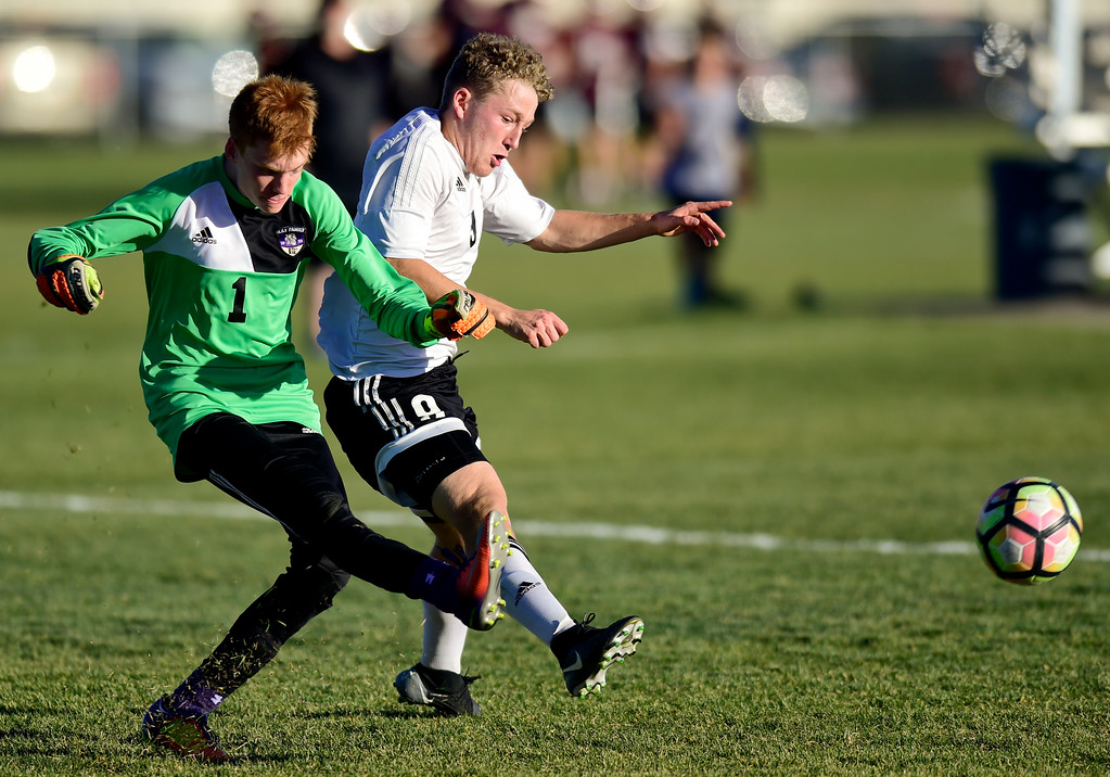 . Silver Creek Jake Levin (No. 9) challenges Holy Family\'s goal keeper Ryan Berry (No. 1) during the first round of class 4A soccer playoffs in Longmont, Colorado on Oct. 25, 2017.  (Photo by Matthew Jonas/Times-Call)