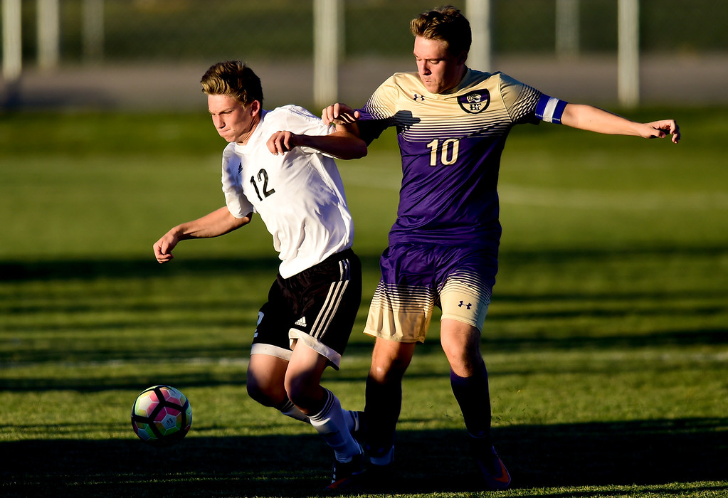 . Holy Family Darin Chavers (No. 10) collides with Silver Creek Connor Peskin (No. 12) during the first round of class 4A soccer playoffs in Longmont, Colorado on Oct. 25, 2017.  (Photo by Matthew Jonas/Times-Call)