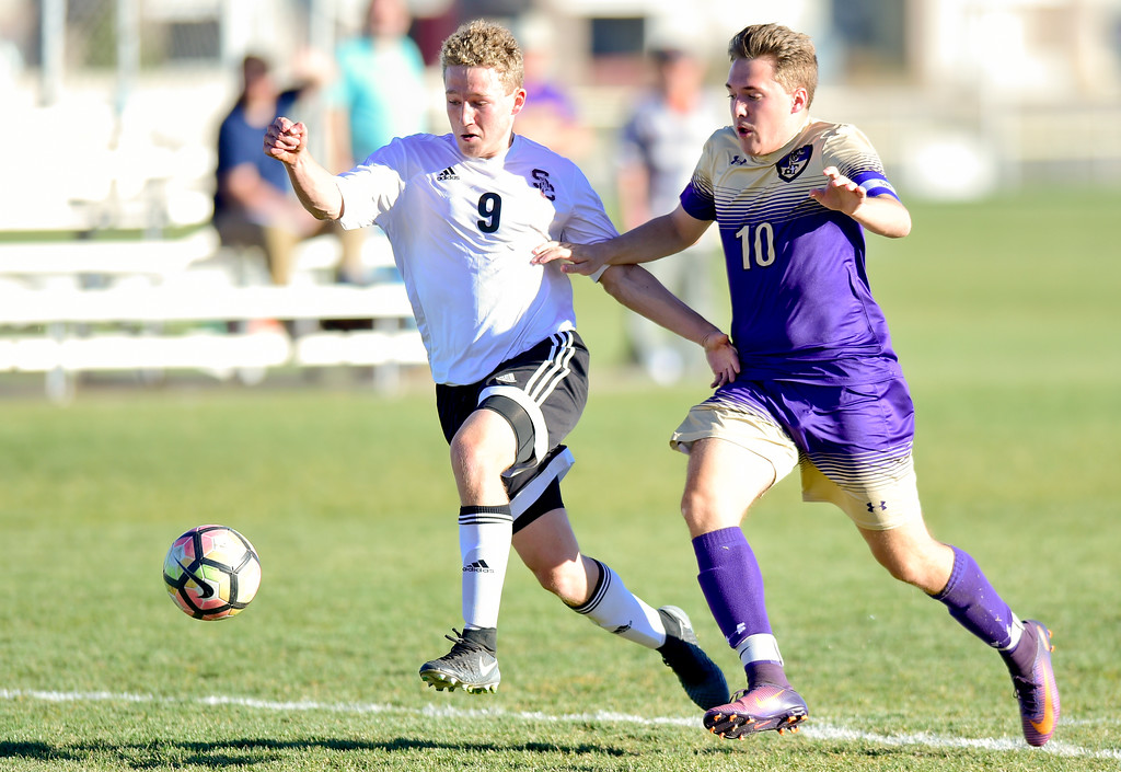 . Silver Creek Jake Levin (No. 9) drives in to score the game winning goal while pressured by Holy Family Darin Chavers (No. 10) during the first round of class 4A soccer playoffs in Longmont, Colorado on Oct. 25, 2017.  (Photo by Matthew Jonas/Times-Call)