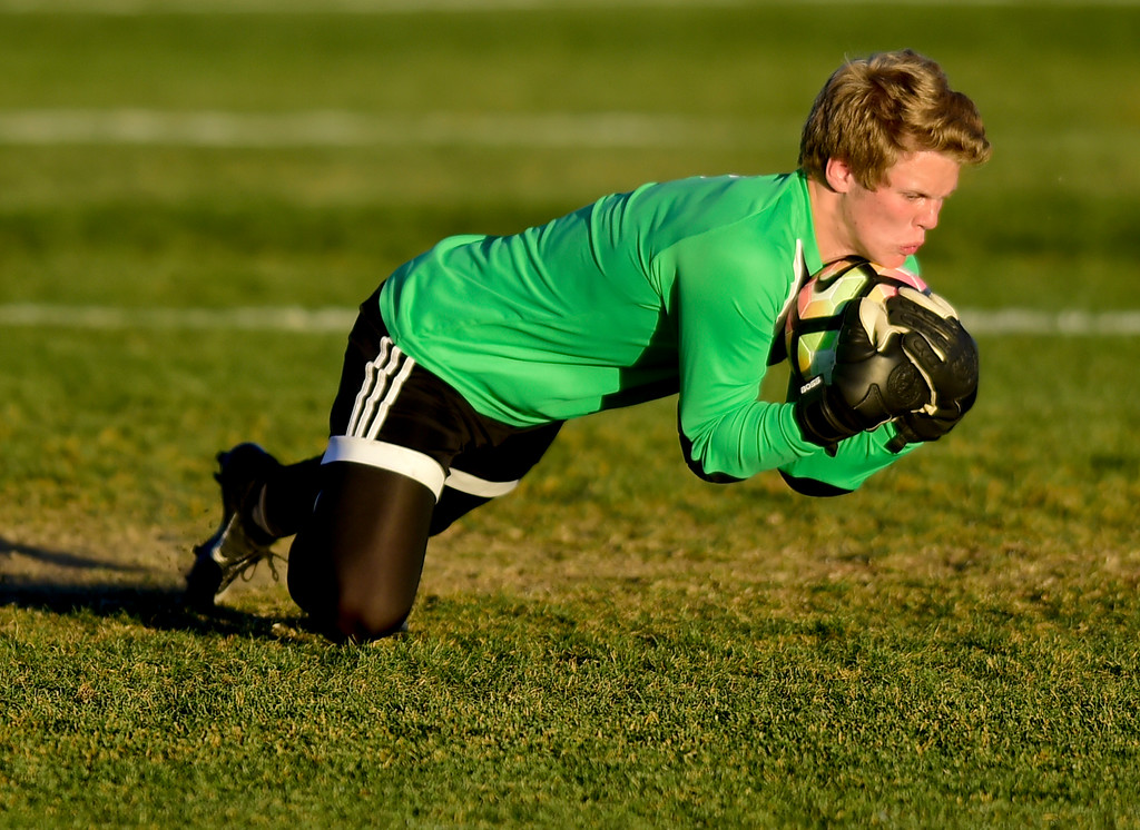 . Silver Creek\'s goal keeper Brandon Coder (No. 1) makes a save against Holy Family during the first round of class 4A soccer playoffs in Longmont, Colorado on Oct. 25, 2017.  (Photo by Matthew Jonas/Times-Call)