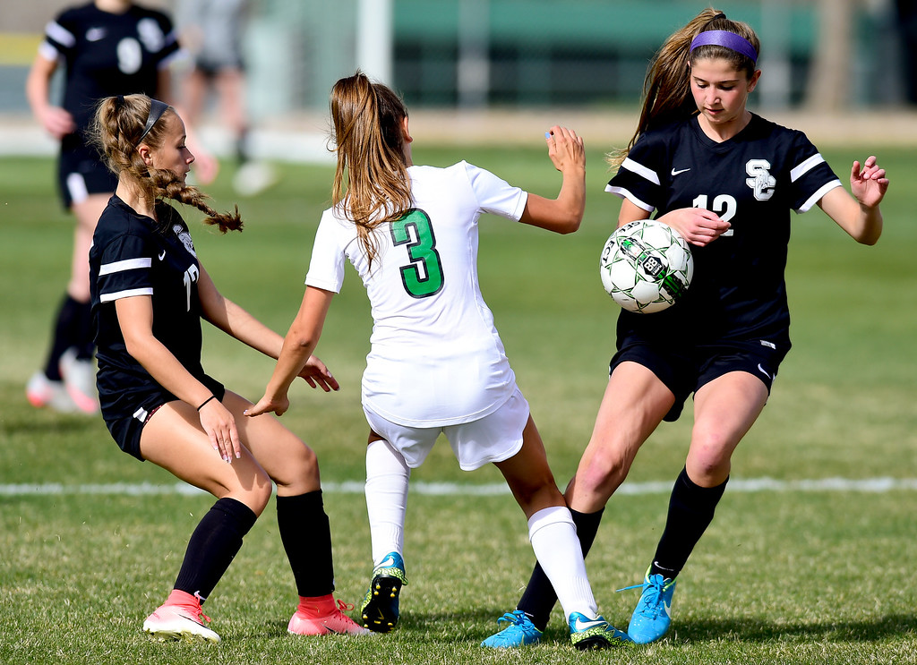 . Silver Creek High School\'s Alexa Karsel (No. 12) and Jordy Victor (No. 17) cut off Niwot High School\'s Lauren Cranny (No. 3) from the ball in Niwot, Colorado on April 10, 2018. (Photo by Matthew Jonas/Staff Photographer)