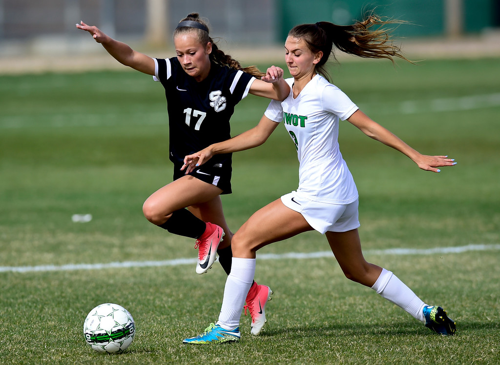 . Niwot High School\'s Lauren Cranny (No. 3) and Silver Creek High School\'s Jordy Victor (No. 17) battle for the ball in Niwot, Colorado on April 10, 2018. (Photo by Matthew Jonas/Staff Photographer)