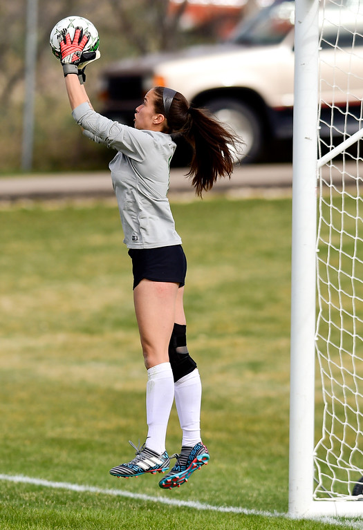 . Niwot High School\'s Allie Colvin (No. 1) makes a save against Silver Creek High School in Niwot, Colorado on April 10, 2018. (Photo by Matthew Jonas/Staff Photographer)