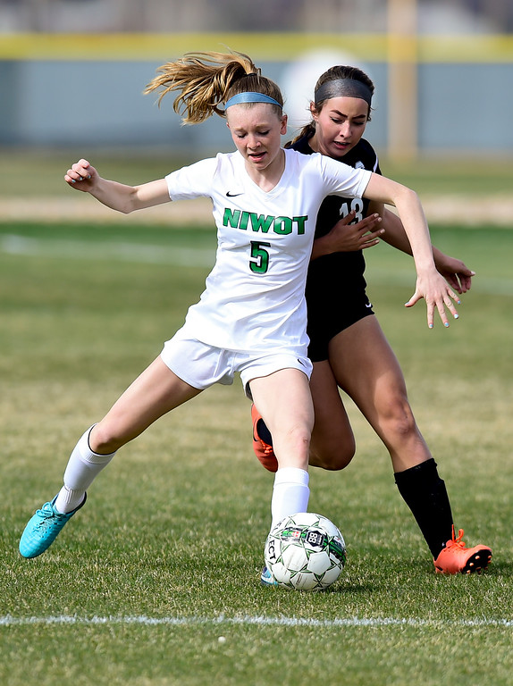 . Niwot High School\'s Kiera Flanagan (No. 5) and Silver Creek High School\'s Mallory Lopez (No. 13) collide while chasing down ball in Niwot, Colorado on April 10, 2018. (Photo by Matthew Jonas/Staff Photographer)
