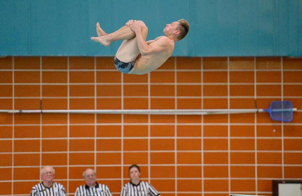 . Silver Creek High School\'s Ashton Hubert dives during a meet with Longmont High School in Longmont, Colorado on April 12, 2018. (Photo by Matthew Jonas/Staff Photographer)