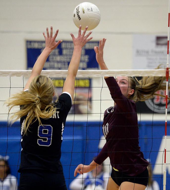 . LONGMONT, CO: September 18: Silver Creek\'s Caitlin Volkmann, tries to get the ball over Longmont\'s Autumn Drees. Silver Creek played Longmont at LHS on September 18, 2018.  (photo by Cliff Grassmick/Staff Photographer).