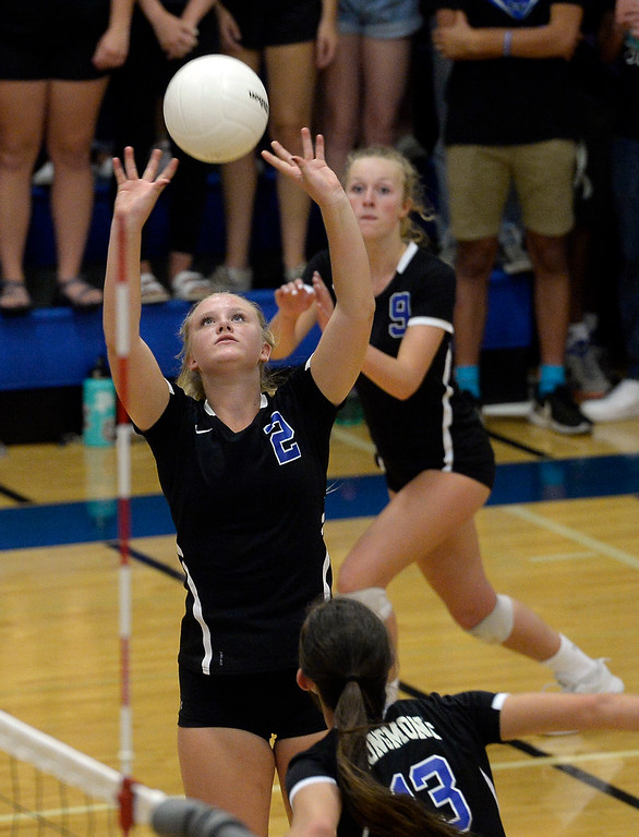 . LONGMONT, CO: September 18: Longmont\'s Annika Wetterstrom set the ball for her teammate. Silver Creek played Longmont at LHS on September 18, 2018.  (photo by Cliff Grassmick/Staff Photographer).