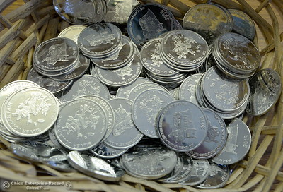 Plastic Silver Dollars good for one dollar off admission are seen inside of the fair office as things get underway at the Silver Dollar Fairgrounds in Chico, Calif. Tues. May 22, 2018.  (Bill Husa -- Photos)