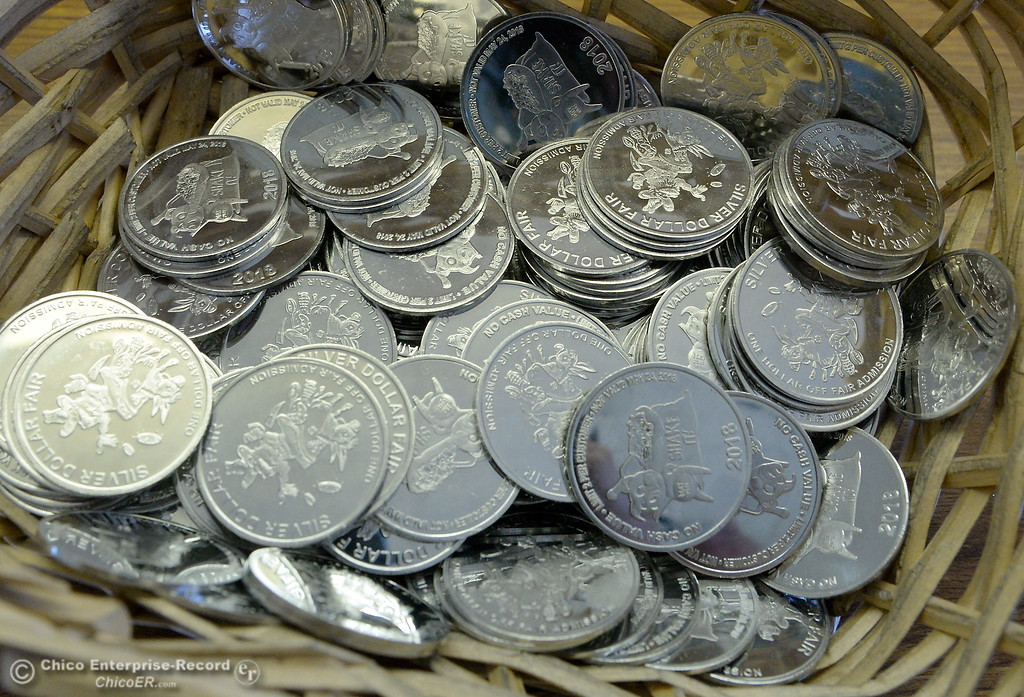 . Plastic Silver Dollars good for one dollar off admission are seen inside of the fair office as things get underway at the Silver Dollar Fairgrounds in Chico, Calif. Tues. May 22, 2018.  (Bill Husa -- Photos)