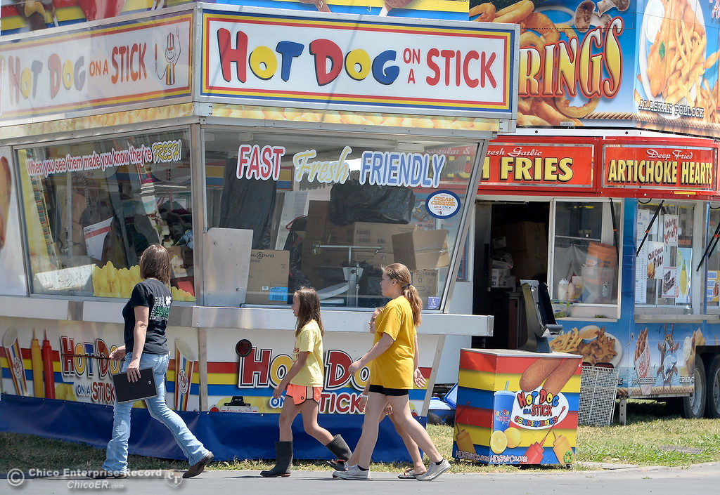 . Fairgoerers will have many choices of food at the fair this year including a hot dog on a stick and Onion Rings as things get underway at the Silver Dollar Fairgrounds in Chico, Calif. Tues. May 22, 2018.  (Bill Husa -- Photos)