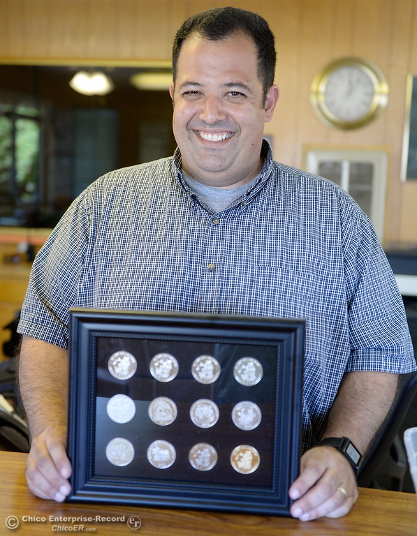 . Silver Dollar Fair Manager Scott Stoller smiles with his collection of Silver Dollar Fair coins as things get underway at the Silver Dollar Fairgrounds in Chico, Calif. Tues. May 22, 2018.  (Bill Husa -- Photos)