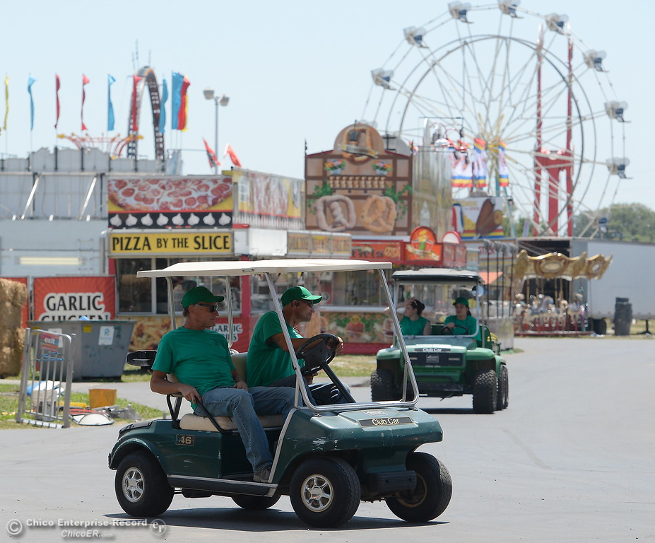 . Golf carts buzz around the midway as things get underway at the Silver Dollar Fairgrounds in Chico, Calif. Tues. May 22, 2018.  (Bill Husa -- Photos)