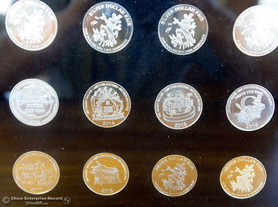 Silver Dollar Fair Manager Scott Stoller smiles with his collection of Silver Dollar Fair coins as things get underway at the Silver Dollar Fairgrounds in Chico, Calif. Tues. May 22, 2018.  (Bill Husa -- Photos)